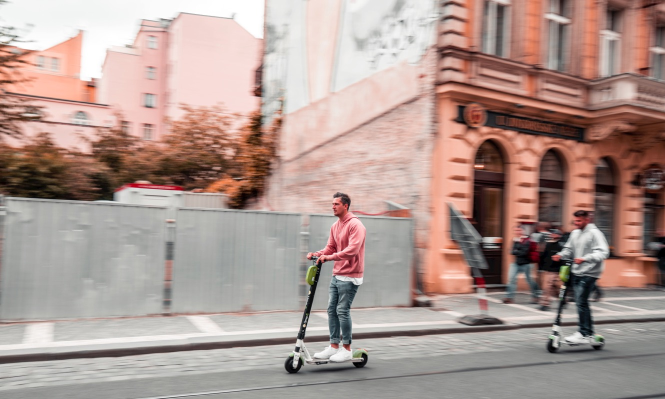 Two men on e-scooters in Prague