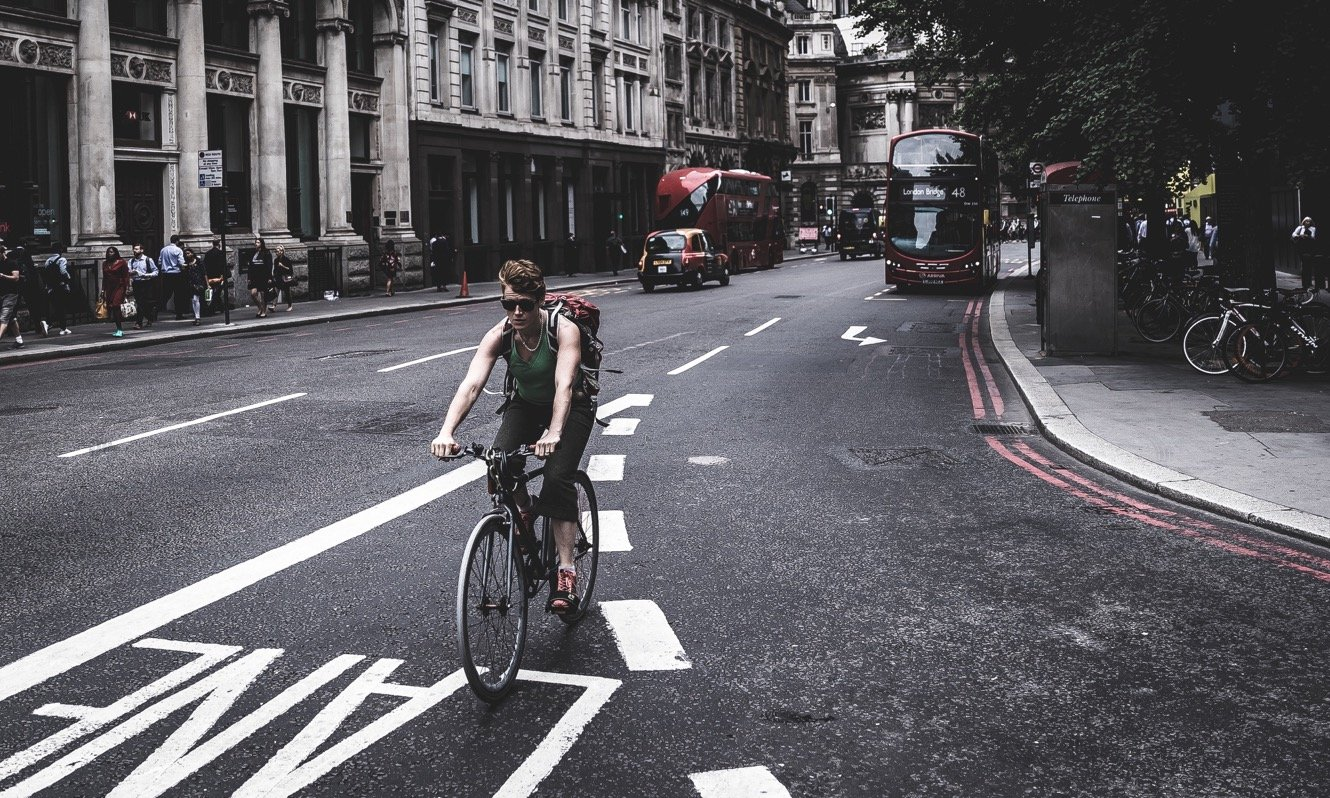 Person cycling in central London