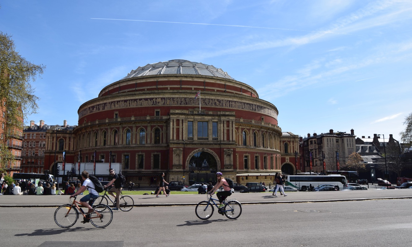 Cyclists going past the Royal Albert Hall