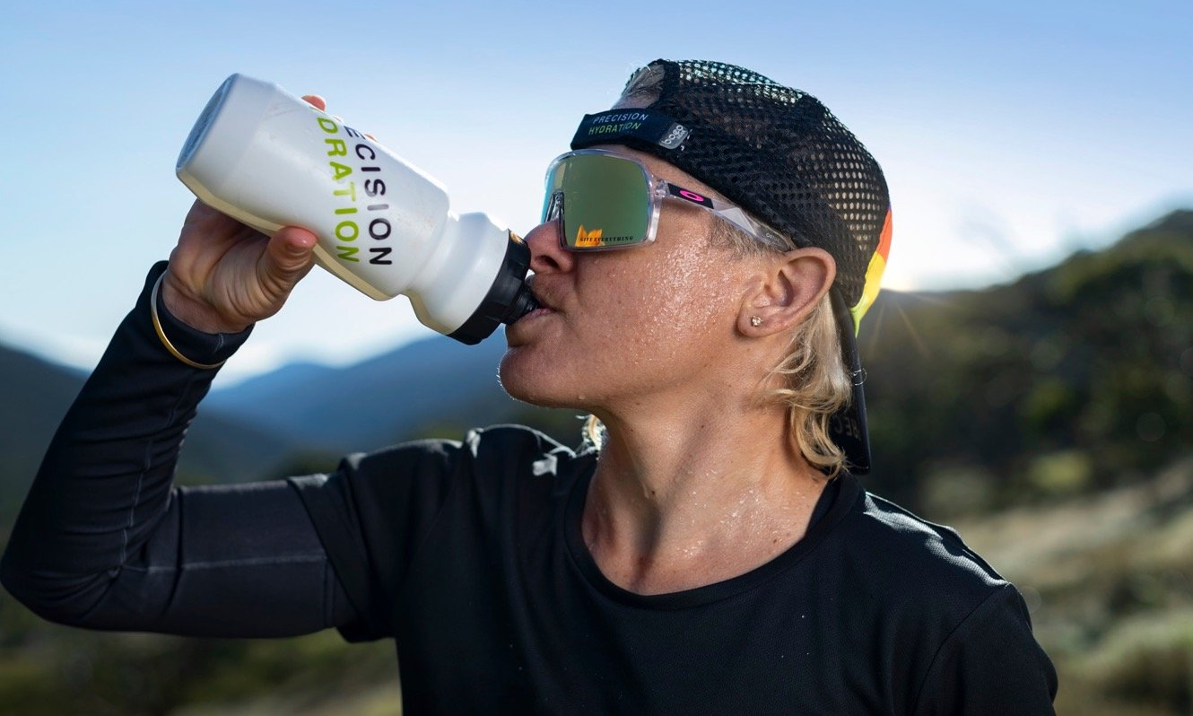Sarah Crowley sweating and drinking from PH bottle
