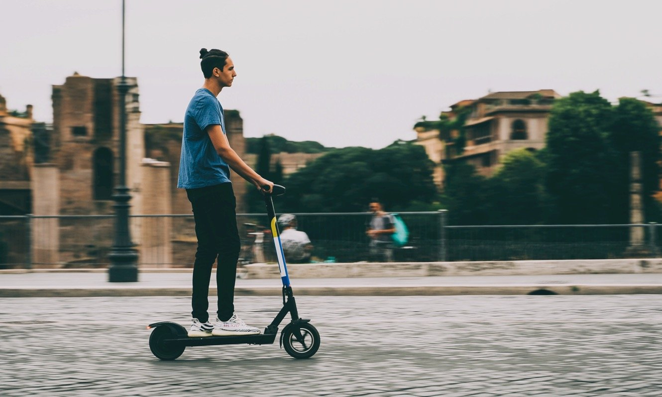 Boy on e-scooter in Rome, Italy