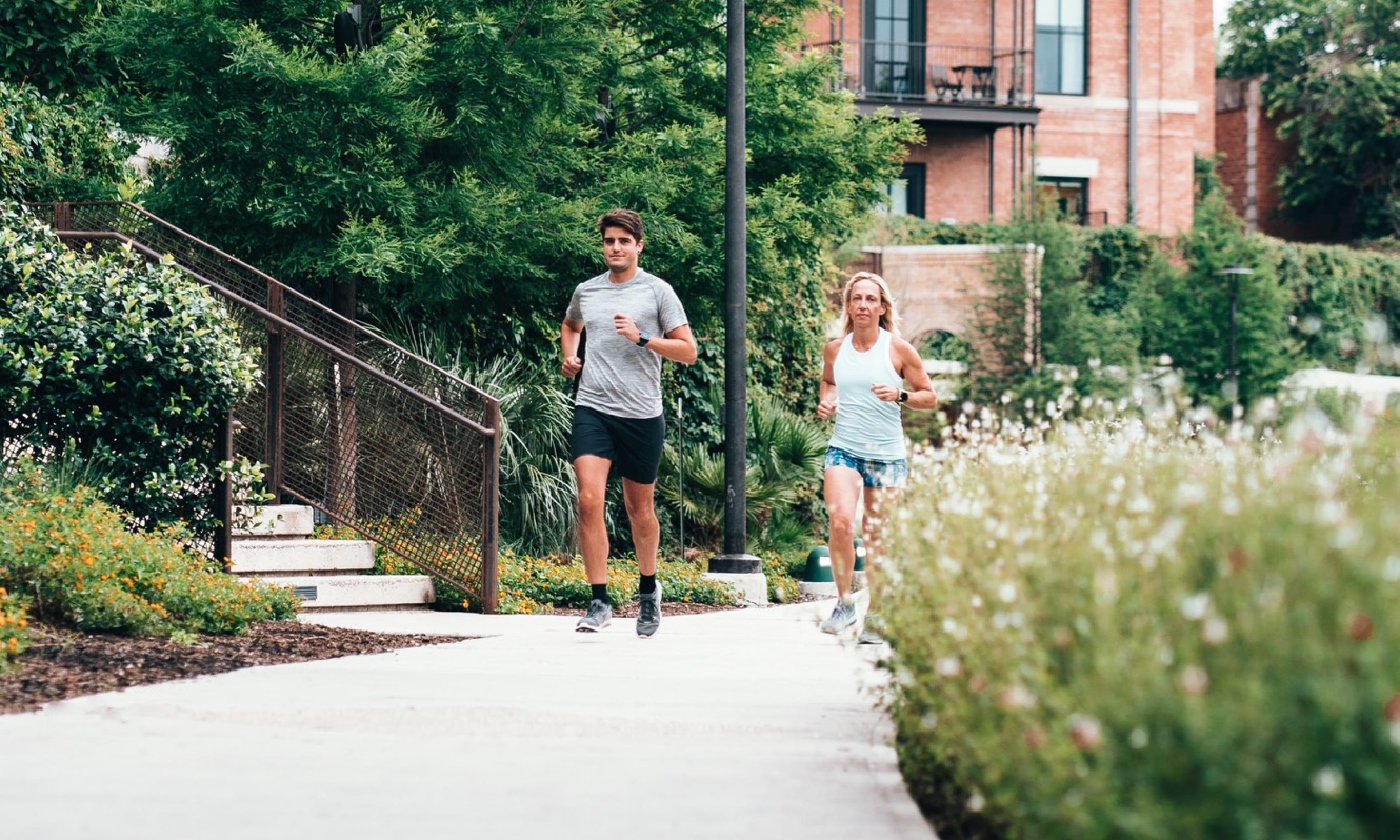 Man and a woman running together