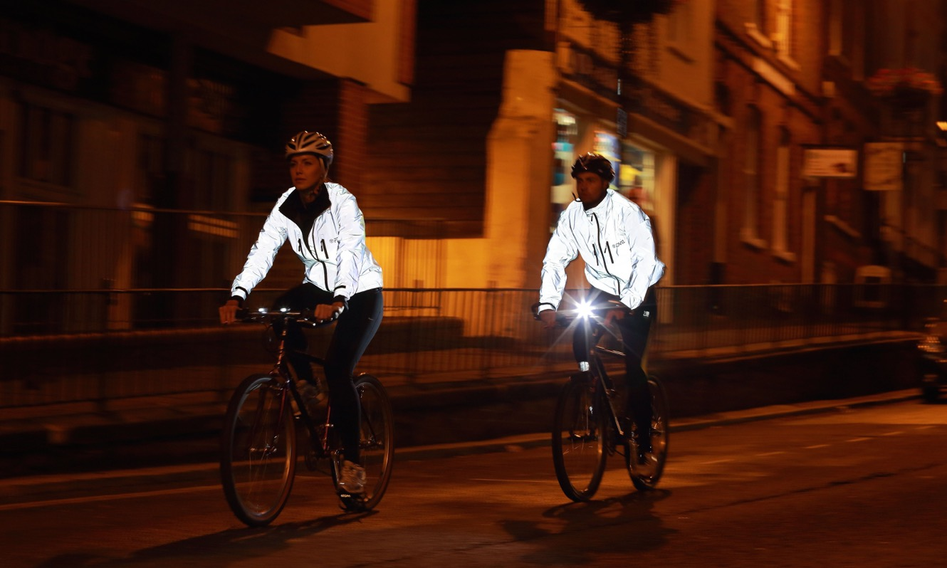 Two Cyclists in Proviz jackets cycling at night