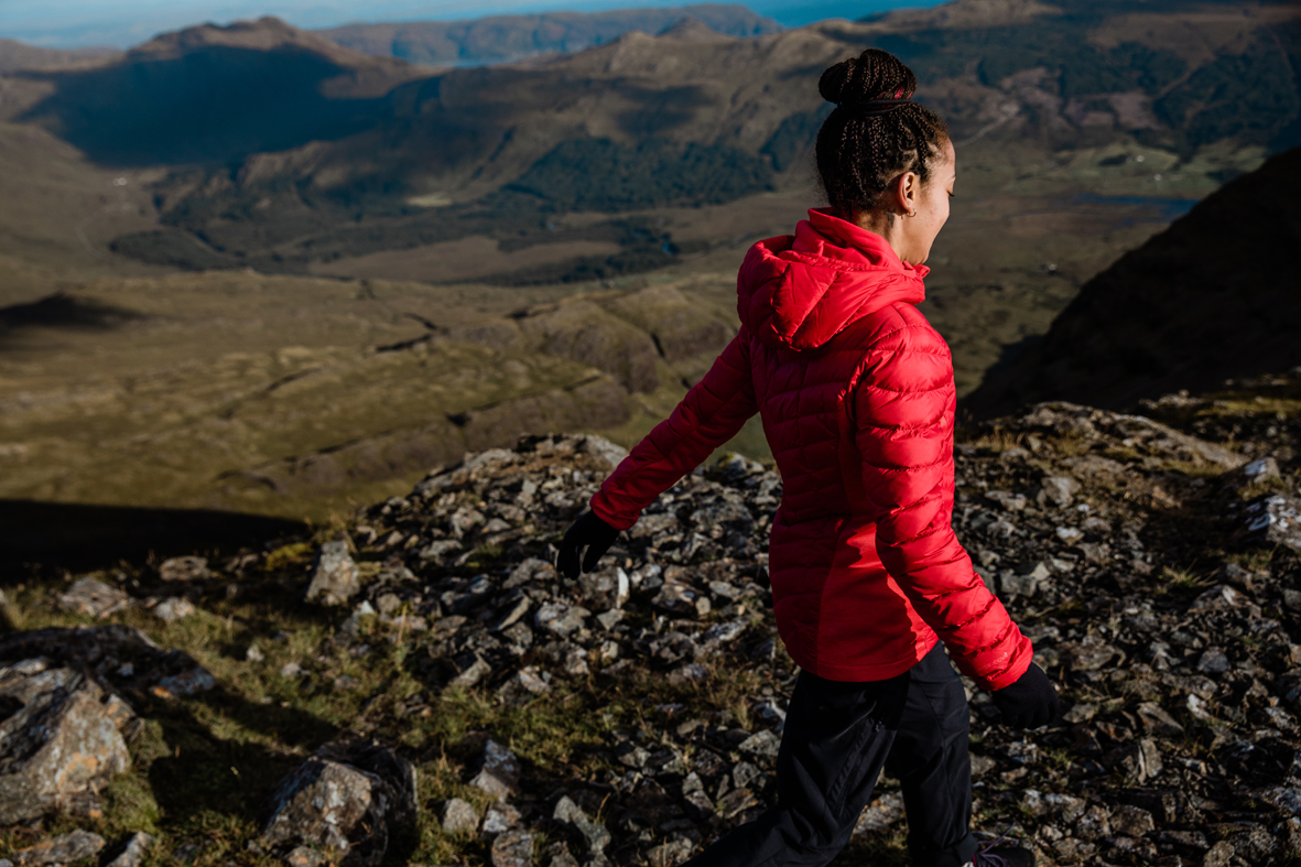 Woman in red down jacket on hill