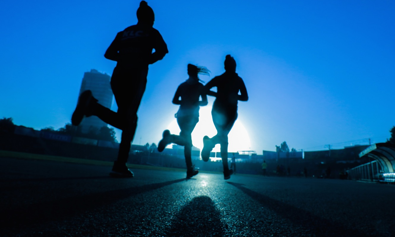 Women running at night in an urban environment