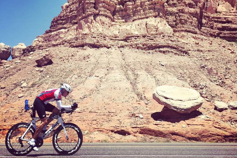Tim cycling through wild American landscape