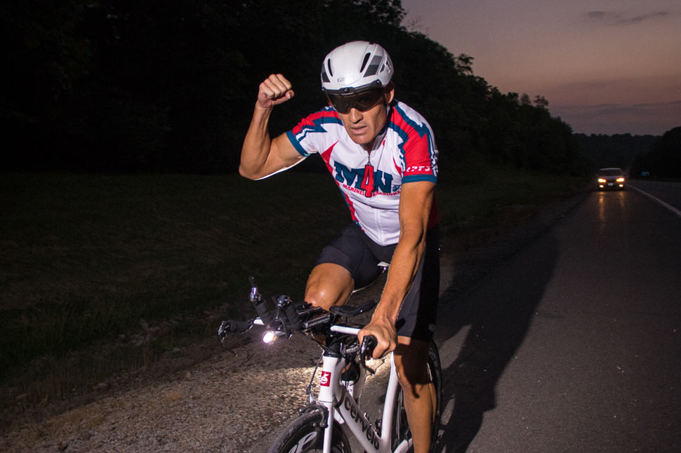 Tim fist pumps as he cycles across America