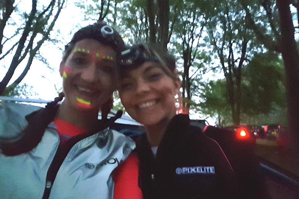 Hannah in her Proviz Gilet and Lianna in the Pixelite jacket about to start their night run