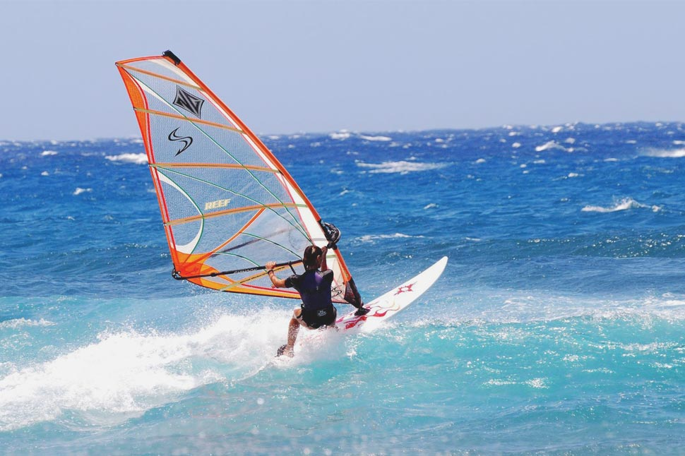 Windsurfing is a fun, adrenalin-fuelled way to exercise on holiday