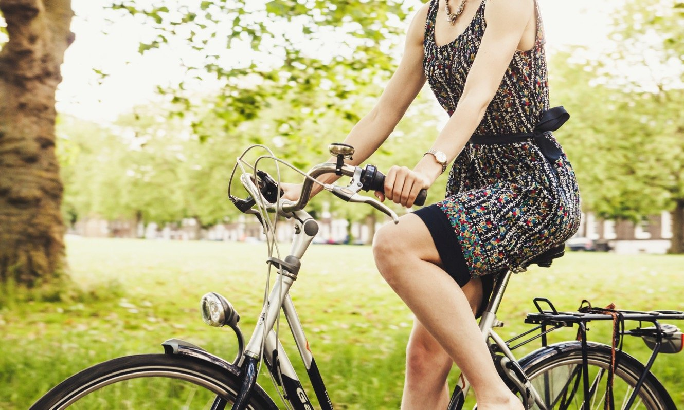 Woman on a bicycle in a London park