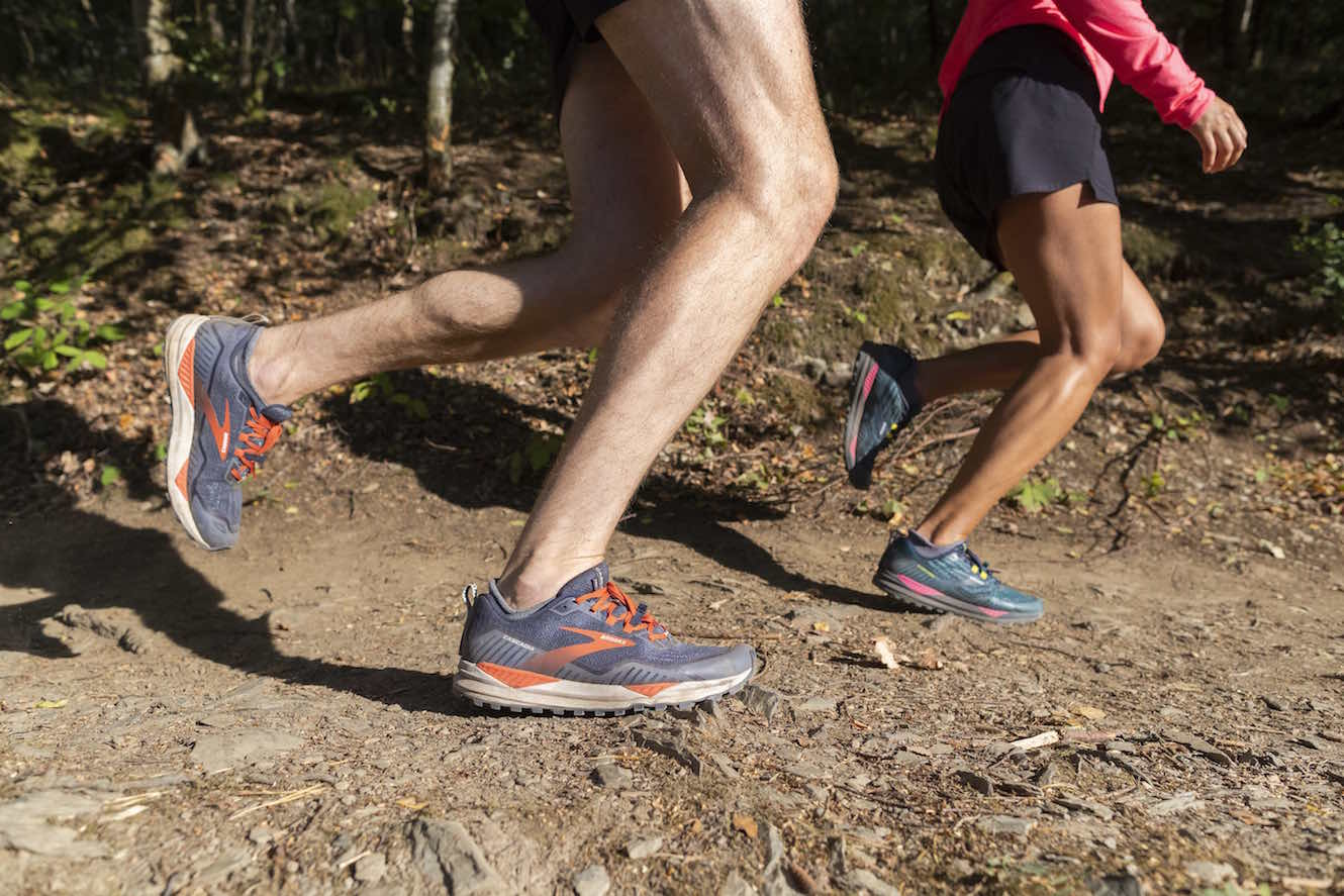 Man and woman trail running
